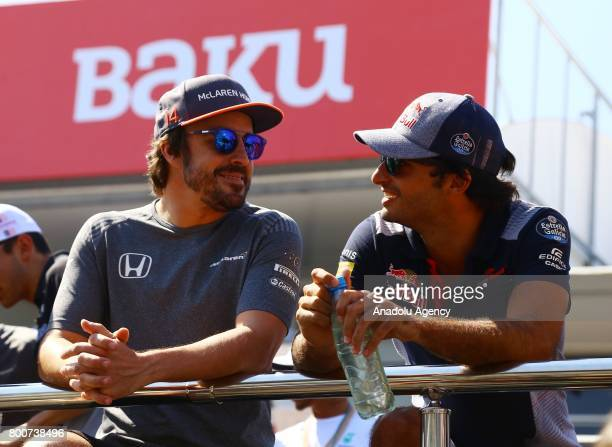 Fernando Alonso of McLaren Honda and Carlos Sainz of Scuderia Toro Rosso talk on the Drivers Parade during an opening ceremony of 2017 Formula 1...