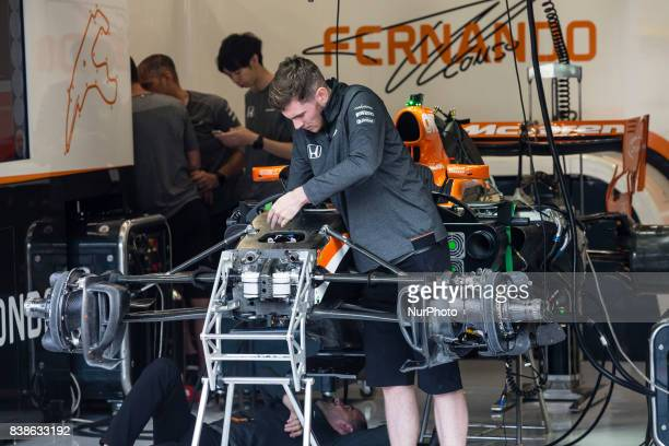 Fernando Alonso of Mclaren Honda machanics working on the car in the box during the Formula One Belgian Grand Prix at Circuit de SpaFrancorchamps on...