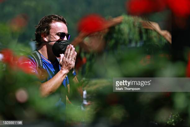 Fernando Alonso of Spain and Alpine F1 Team walks in the Paddock ahead of final practice ahead of the F1 Grand Prix of Styria at Red Bull Ring on...