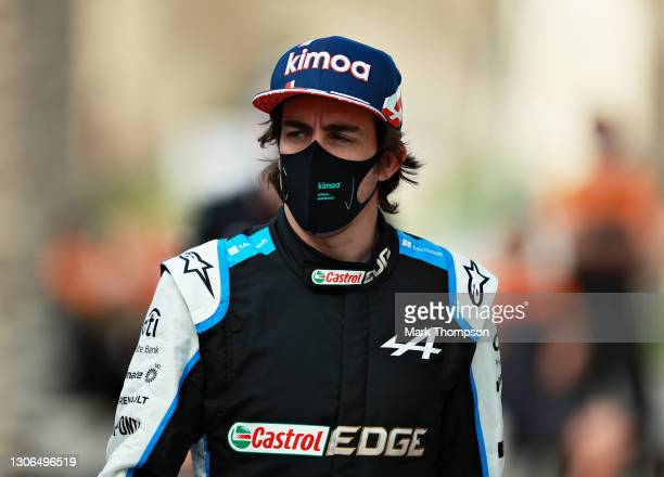 Fernando Alonso of Spain and Alpine F1 Team walks in the Paddock during previews ahead of Formula 1 Testing at Bahrain International Circuit on March...