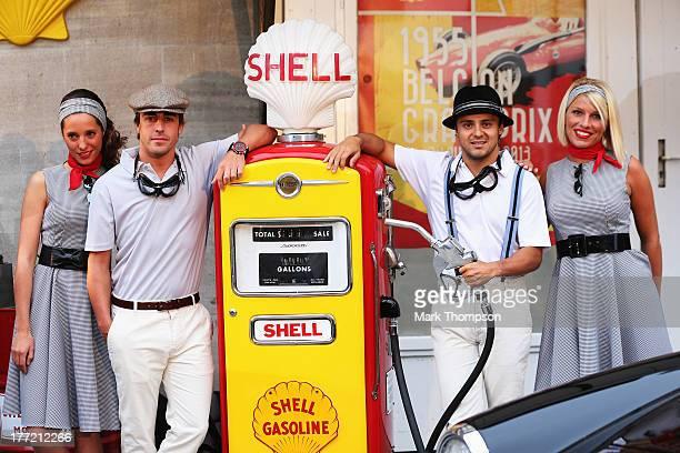 Fernando Alonso of Spain and Ferrari and Felipe Massa of Brazil and Ferrari appear at a 1950's inspired Shell event at Le Globe cinema in Malmedy...