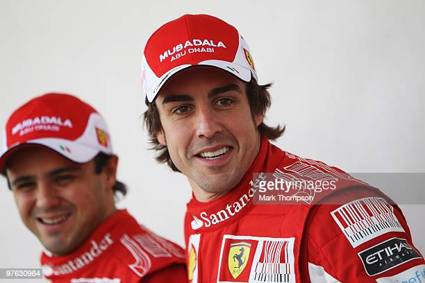 Fernando Alonso of Spain and Ferrari and his team mate Felipe Massa of Brazil and Ferrari attend the drivers official portrait session during...