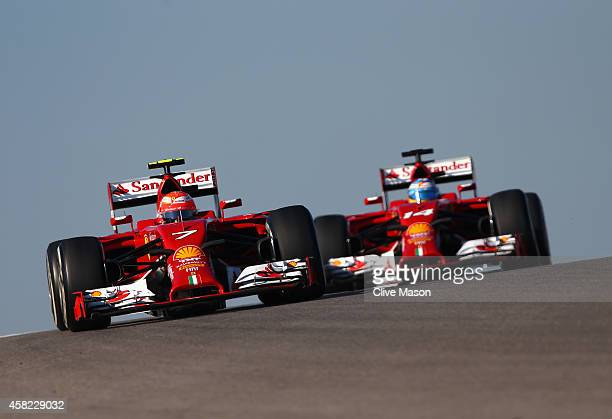 Fernando Alonso of Spain and Ferrari and Kimi Raikkonen of Finland and Ferrari drive during final practice for the United States Formula One Grand...