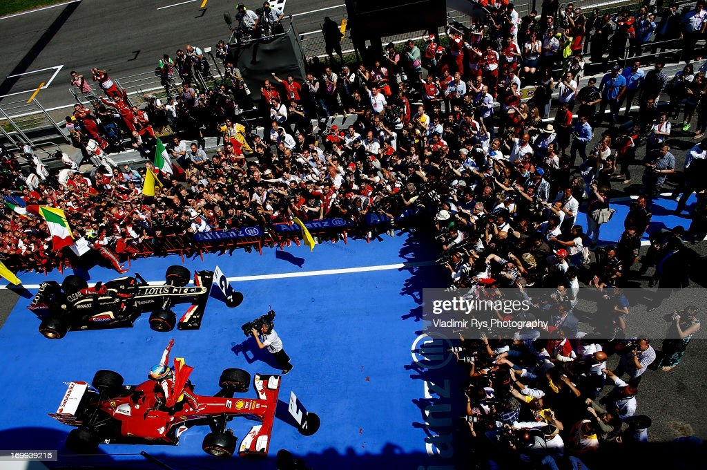 Fernando Alonso of Spain and Ferrari celebrates after winning the Spanish Formula One Grand Prix at the Circuit de Catalunya on May 12, 2013 in Montmelo, Spain.