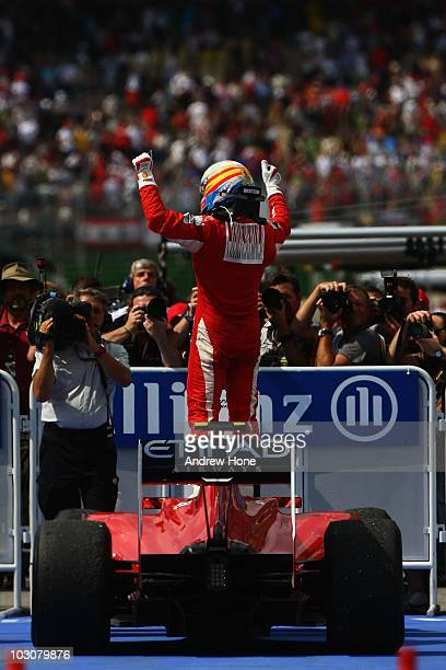 Fernando Alonso of Spain and Ferrari celebrates as he drives into parc ferme after winning the German Grand Prix at Hockenheimring on July 25, 2010...
