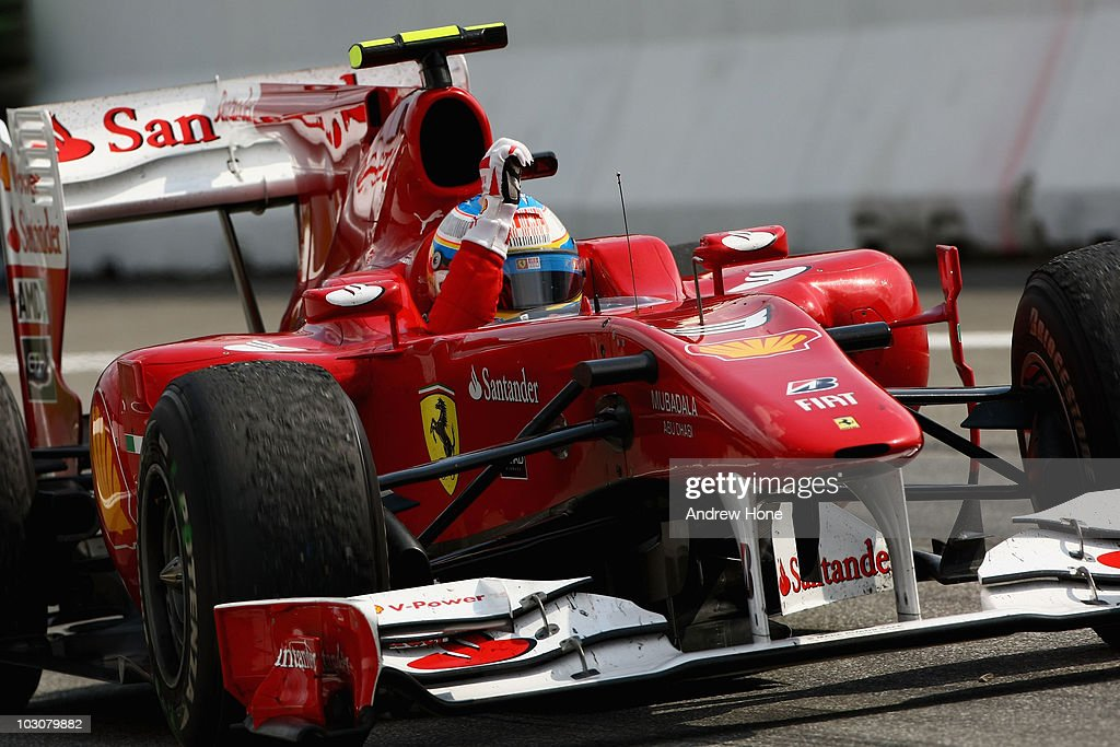 Fernando Alonso of Spain and Ferrari celebrates as he drives into parc ferme after winning the German Grand Prix at Hockenheimring on July 25, 2010 in Hockenheim, Germany.
