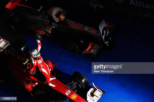 Fernando Alonso of Spain and Ferrari celebrates in parc ferme after winning the Korean Formula One Grand Prix at the Korea International Circuit on...