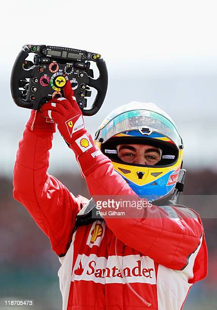 Fernando Alonso of Spain and Ferrari celebrates in parc ferme after winning the British Formula One Grand Prix at the Silverstone Circuit on July 10,...