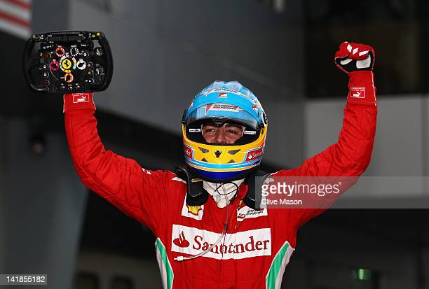 Fernando Alonso of Spain and Ferrari celebrates in parc ferme after winning the Malaysian Formula One Grand Prix at the Sepang Circuit on March 25...