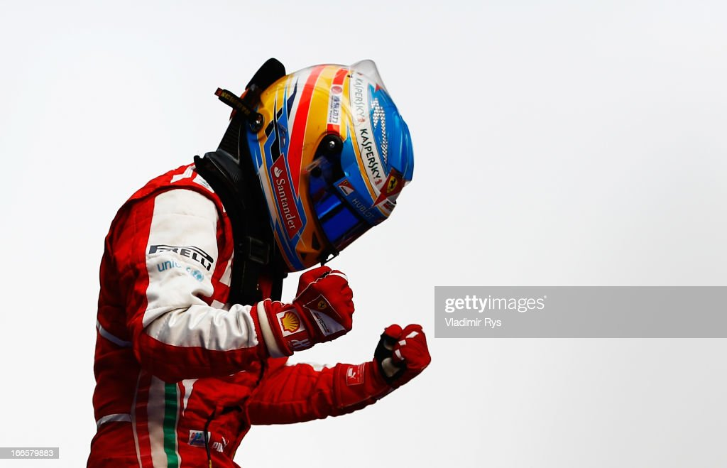 Fernando Alonso of Spain and Ferrari celebrates in parc ferme after winning the Chinese Formula One Grand Prix at the Shanghai International Circuit on April 14, 2013 in Shanghai, China.