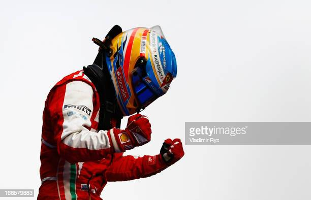 Fernando Alonso of Spain and Ferrari celebrates in parc ferme after winning the Chinese Formula One Grand Prix at the Shanghai International Circuit...