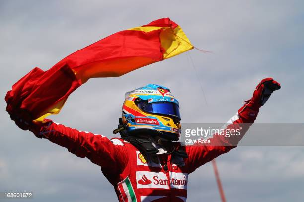 Fernando Alonso of Spain and Ferrari celebrates in parc ferme after winning the Spanish Formula One Grand Prix at the Circuit de Catalunya on May 12,...
