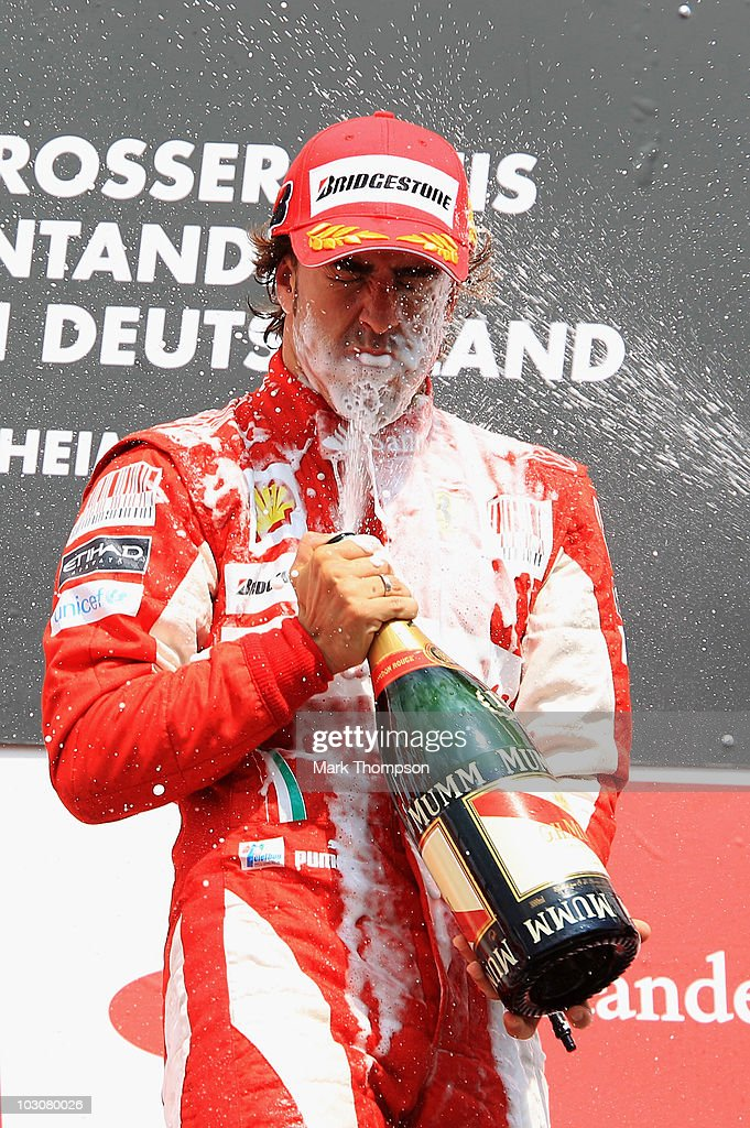 Fernando Alonso of Spain and Ferrari celebrates on the podium after winning the German Grand Prix at Hockenheimring on July 25, 2010 in Hockenheim, Germany.