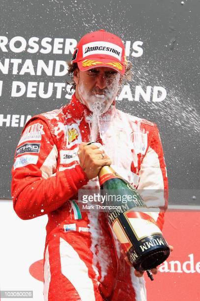 Fernando Alonso of Spain and Ferrari celebrates on the podium after winning the German Grand Prix at Hockenheimring on July 25, 2010 in Hockenheim,...