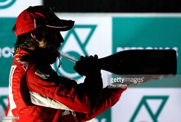 Fernando Alonso of Spain and Ferrari celebrates on the podium after winning the Korean Formula One Grand Prix at the Korea International Circuit on...