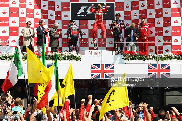 Fernando Alonso of Spain and Ferrari celebrates on the podium after winning the British Formula One Grand Prix at the Silverstone Circuit on July 10,...