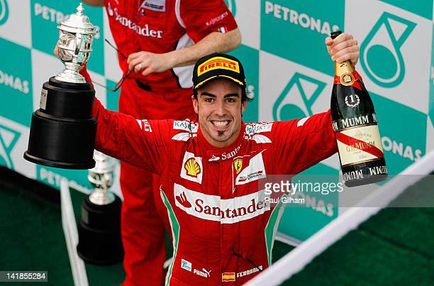 Fernando Alonso of Spain and Ferrari celebrates on the podium after winning the Malaysian Formula One Grand Prix at the Sepang Circuit on March 25...