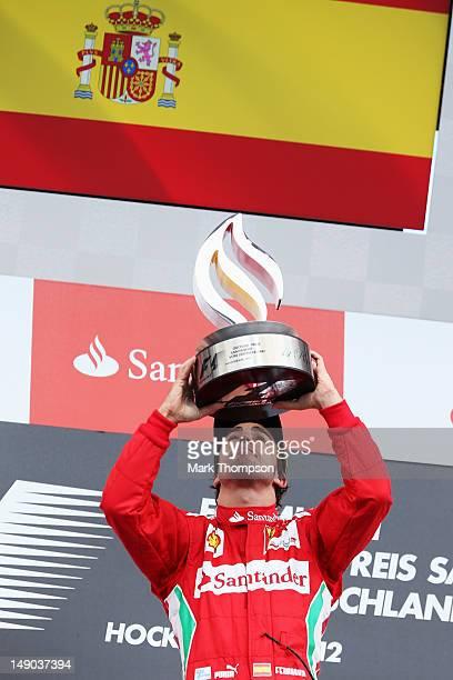Fernando Alonso of Spain and Ferrari celebrates on the podium after winning the German Grand Prix at Hockenheimring on July 22, 2012 in Hockenheim,...