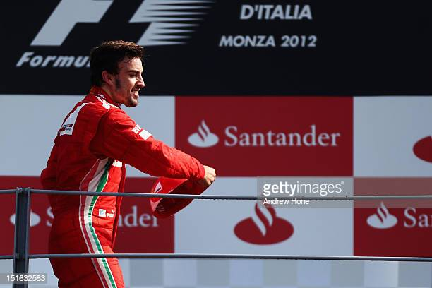 Fernando Alonso of Spain and Ferrari celebrates on the podium after finishing third during the Italian Formula One Grand Prix at the Autodromo...