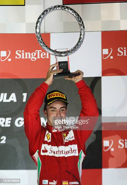 Fernando Alonso of Spain and Ferrari celebrates on the podium after finishing third during the Singapore Formula One Grand Prix at the Marina Bay...