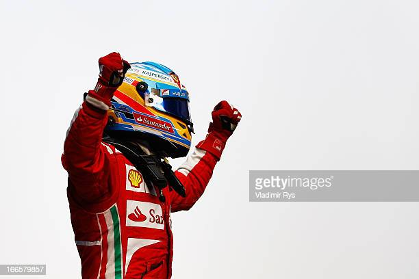 Fernando Alonso of Spain and Ferrari celebrates on the podium after winning the Chinese Formula One Grand Prix at the Shanghai International Circuit...