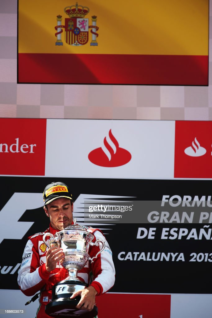Fernando Alonso of Spain and Ferrari celebrates on the podium after winning the Spanish Formula One Grand Prix at the Circuit de Catalunya on May 12, 2013 in Montmelo, Spain.