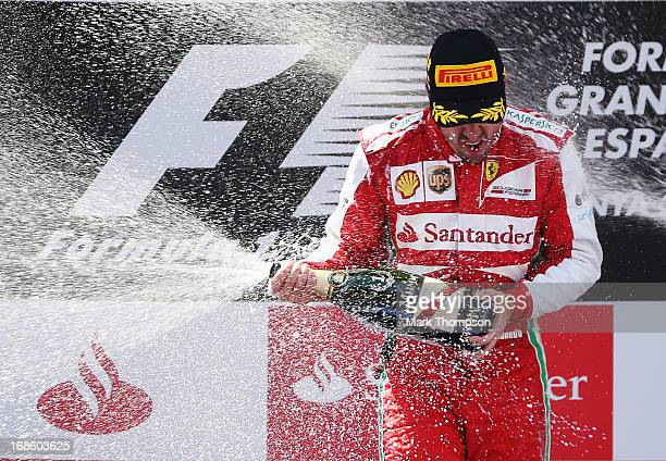 Fernando Alonso of Spain and Ferrari celebrates on the podium after winning the Spanish Formula One Grand Prix at the Circuit de Catalunya on May 12,...