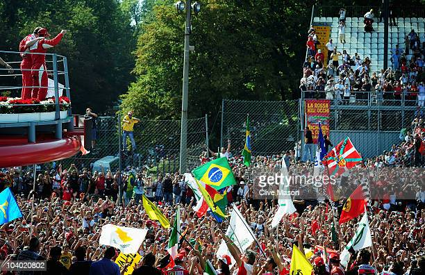 Fernando Alonso of Spain and Ferrari celebrates on the podium with third placed team mate Felipe Massa of Brazil and Ferrari and Ferrari Team...