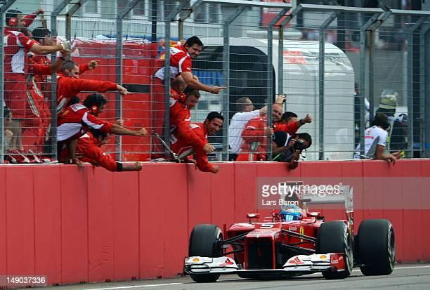 Fernando Alonso of Spain and Ferrari crosses the line to win the German Grand Prix at Hockenheimring on July 22, 2012 in Hockenheim, Germany.