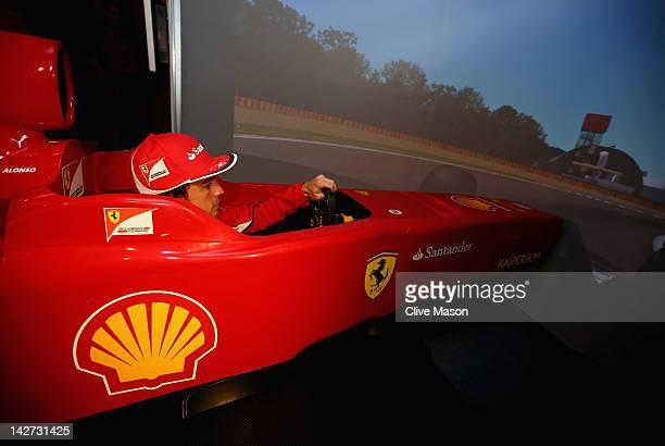 Fernando Alonso of Spain and Ferrari drives a Ferrari Formula One simulator at the Four Seasons Hotel on April 12, 2012 in Shanghai, China.
