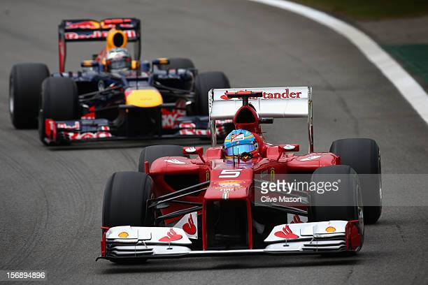 Fernando Alonso of Spain and Ferrari drives ahead of Sebastian Vettel of Germany and Red Bull Racing during the final practice session prior to...