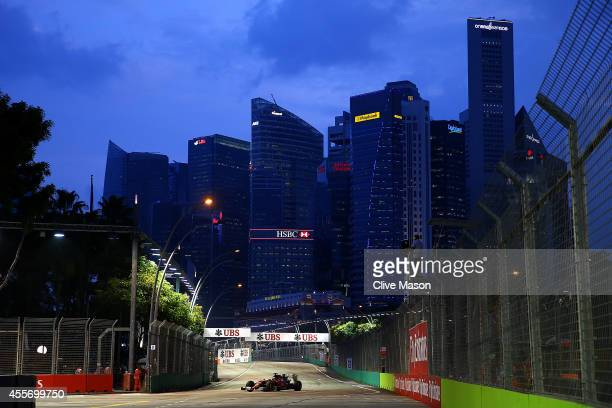 Fernando Alonso of Spain and Ferrari drives during practice ahead of the Singapore Formula One Grand Prix at Marina Bay Street Circuit on September...