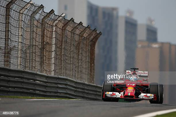 Fernando Alonso of Spain and Ferrari drives during practice ahead of the Chinese Formula One Grand Prix at the Shanghai International Circuit on...