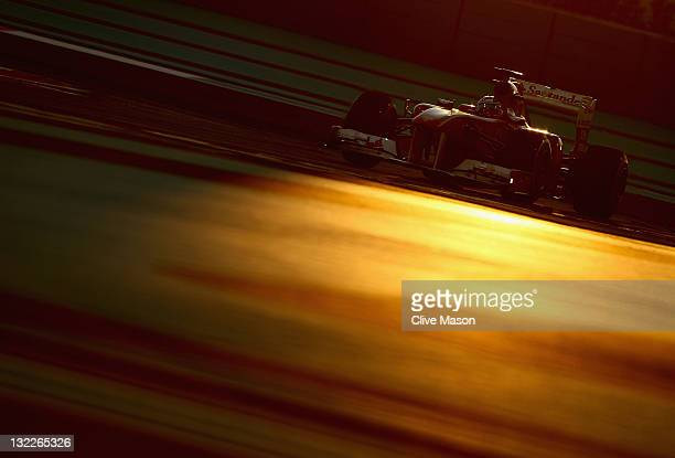 Fernando Alonso of Spain and Ferrari drives during practice for the Abu Dhabi Formula One Grand Prix at the Yas Marina Circuit on November 11 2011 in...
