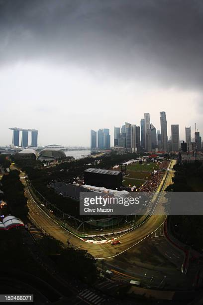 Fernando Alonso of Spain and Ferrari drives during practice for the Singapore Formula One Grand Prix at the Marina Bay Street Circuit on September...