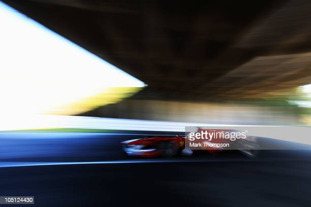 Fernando Alonso of Spain and Ferrari drives during qualifying for the Japanese Formula One Grand Prix at Suzuka Circuit on October 10 2010 in Suzuka...