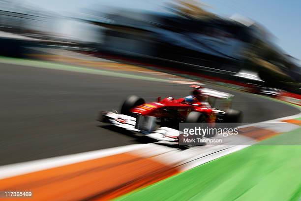 Fernando Alonso of Spain and Ferrari drives during the European Formula One Grand Prix at the Valencia Street Circuit on July 26 in Valencia, Spain.