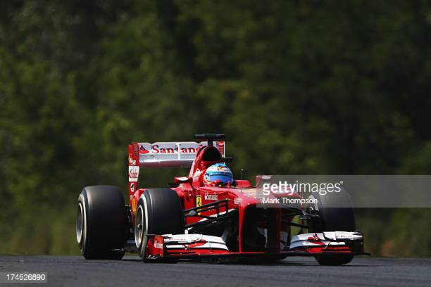 Fernando Alonso of Spain and Ferrari drives during the final practice session prior to qualifying for the Hungarian Formula One Grand Prix at...