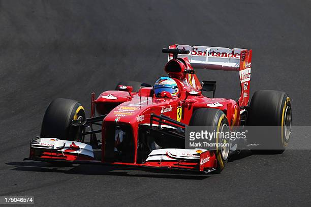 Fernando Alonso of Spain and Ferrari drives during the Hungarian Formula One Grand Prix at Hungaroring on July 28 2013 in Budapest Hungary
