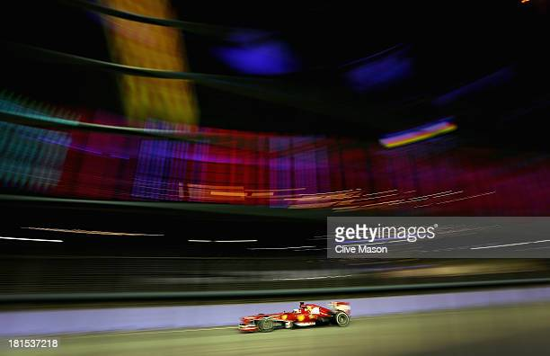 Fernando Alonso of Spain and Ferrari drives during the Singapore Formula One Grand Prix at Marina Bay Street Circuit on September 22 2013 in...