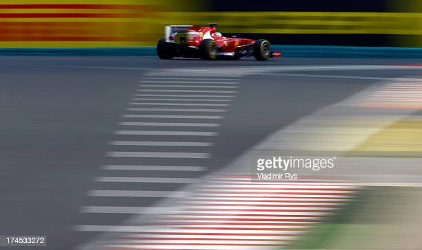 Fernando Alonso of Spain and Ferrari drives his Ferrari F138 during qualifying for the Hungarian Formula One Grand Prix at Hungaroring on July 27...