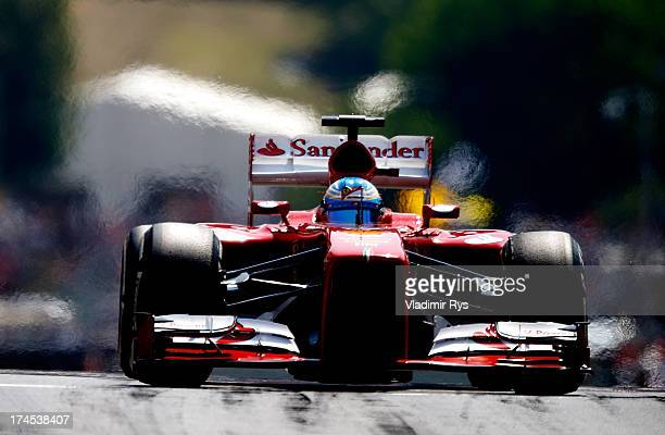 Fernando Alonso of Spain and Ferrari drives his Ferrari F138 during practice prior qualifying for the Hungarian Formula One Grand Prix at Hungaroring...