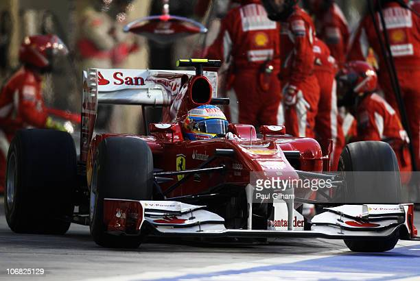 Fernando Alonso of Spain and Ferrari drives in for a pitstop during the Abu Dhabi Formula One Grand Prix at the Yas Marina Circuit on November 14...