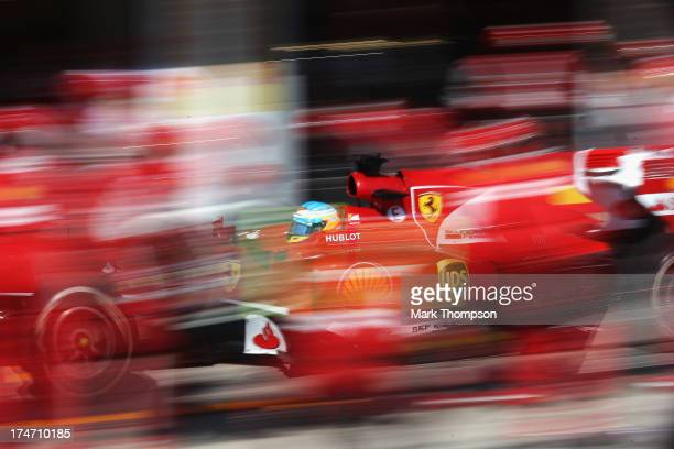 Fernando Alonso of Spain and Ferrari drives in for a pitstop during the Hungarian Formula One Grand Prix at Hungaroring on July 28 2013 in Budapest...