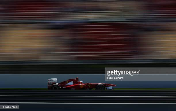Fernando Alonso of Spain and Ferrari drives in the final practice session prior to qualifying for the Spanish Formula One Grand Prix at the Circuit...
