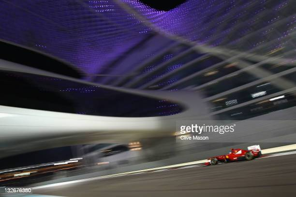 Fernando Alonso of Spain and Ferrari drives on his way to finishing second during the Abu Dhabi Formula One Grand Prix at the Yas Marina Circuit on...