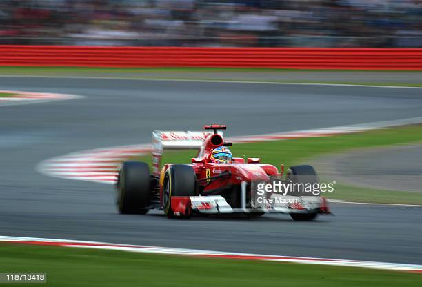 Fernando Alonso of Spain and Ferrari drives on his way to winning the British Formula One Grand Prix at the Silverstone Circuit on July 10, 2011 in...