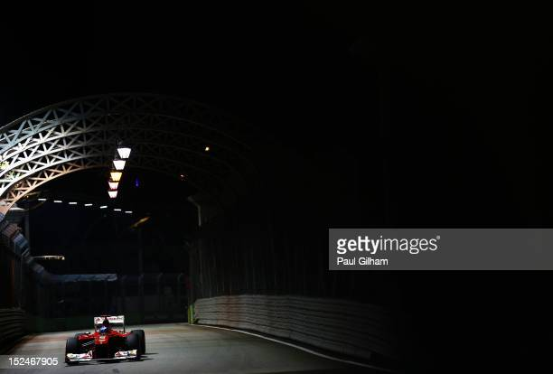 Fernando Alonso of Spain and Ferrari drives over the Anderson Bridge during practice for the Singapore Formula One Grand Prix at the Marina Bay...