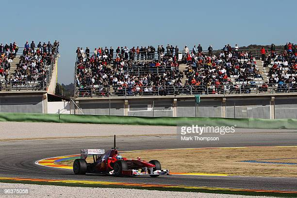 Fernando Alonso of Spain and Ferrari drives the new F10 for the first time in front of large local crowd during winter testing at the Ricardo Tormo...