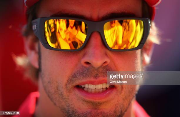Fernando Alonso of Spain and Ferrari is interviewed by the media during previews to the Italian Formula One Grand Prix at Autodromo di Monza on...